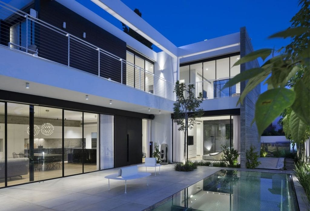 Steel window with minimalist steel profile and external shade. Modern design style.