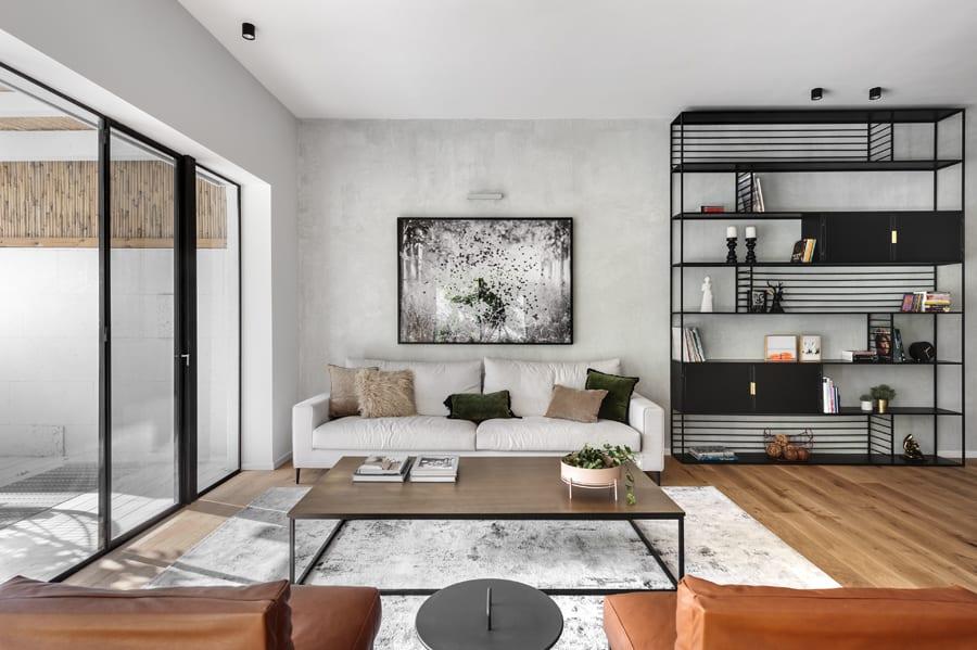 Huge steel window with sliding opening and sliding door with minimalist black steel profile. Modern style design.