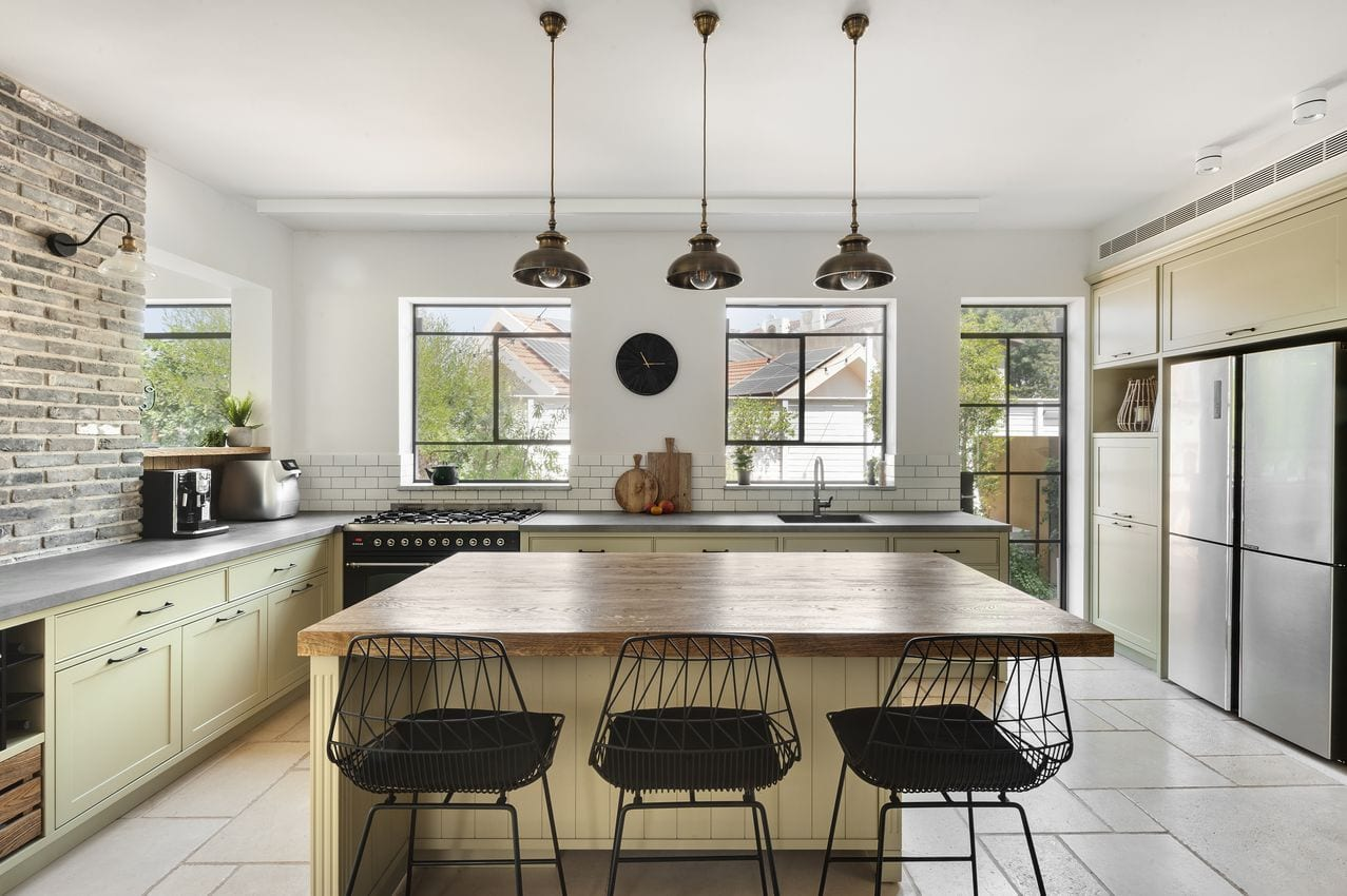 Iron windows are decorated in the kitchen. A combination of a minimalist iron profile and insulating glass