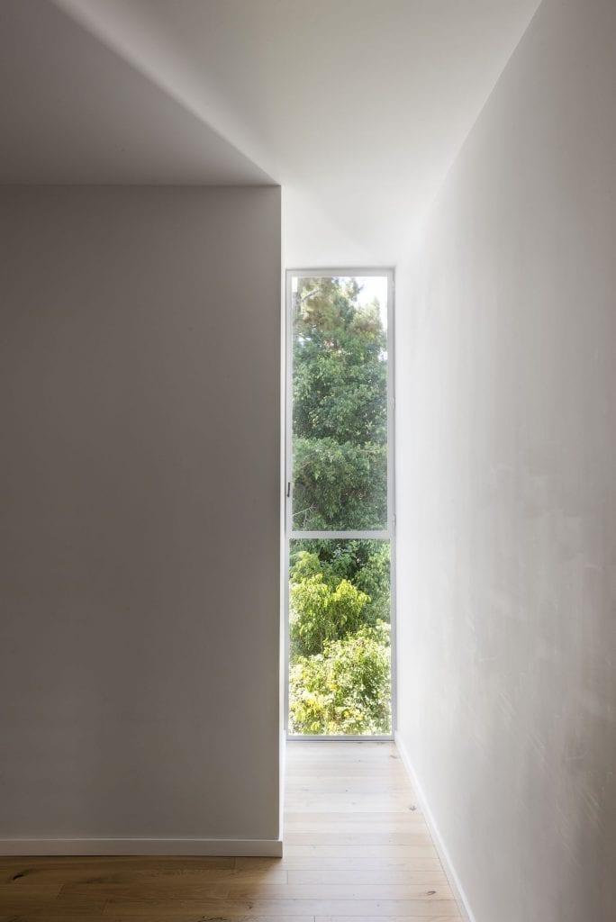 Narrow Belgian window with insulating glass and white iron profile. Thermal window